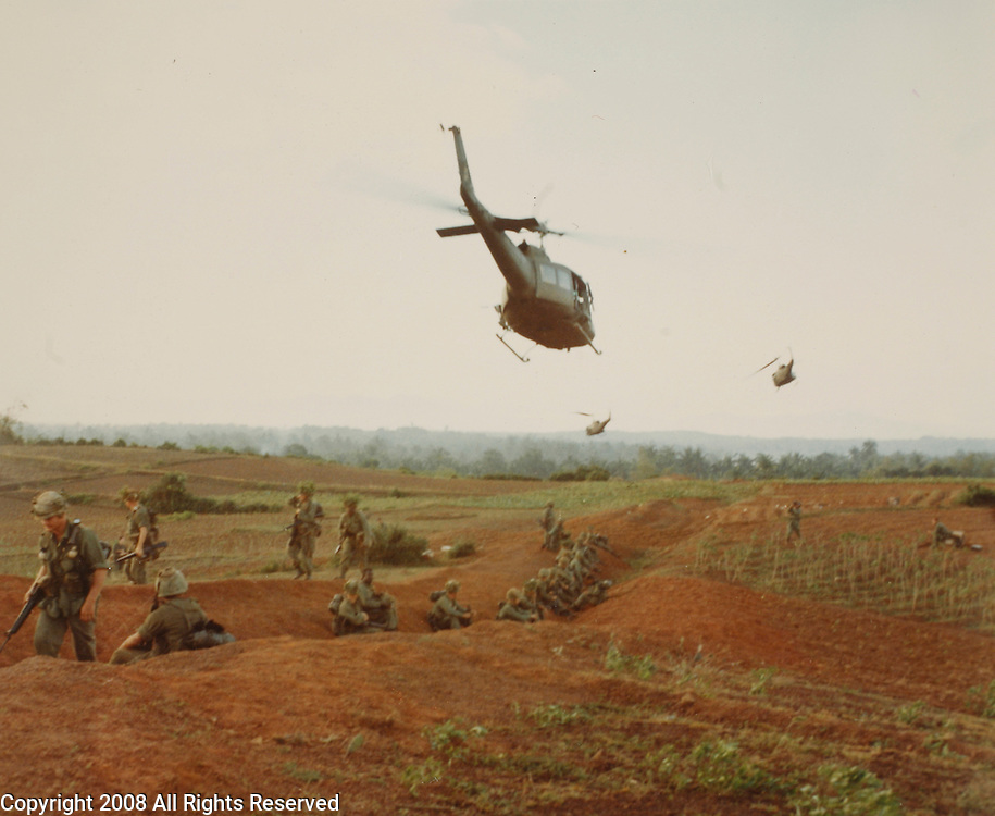 Operation Masher Bong Son, RVN.Troops of the 1st Air Cav Div (Air Mobile) await movement by helicopter for assault against the Viet Cong. 25 January 1966 Photo by Ssg Lyle V. Boggess USA Special Photo Det., Pacific