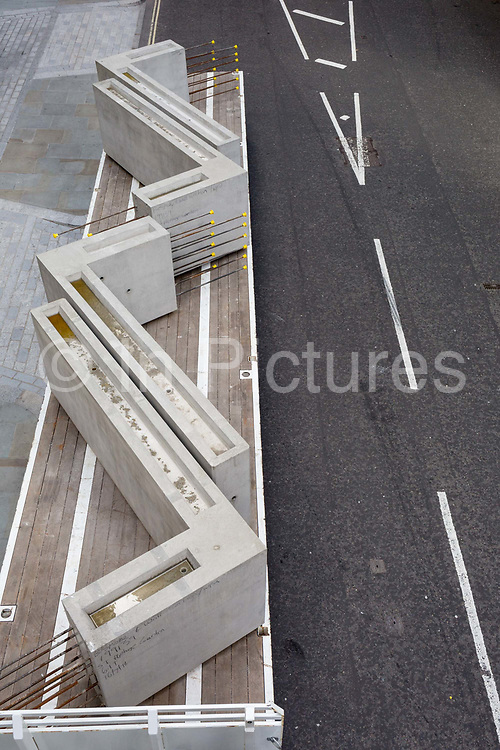 Large concrete right-angled blocks awaiting offloading from a lorry in Wood Street in the City of London - the capitals financial district, on 21st August 2018, in London, England.