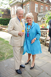 SIR DAVID FROST and JUDITH CHALMERS at the Lord's Taverners Diamond Jubilee Garden Party held in College Gardens, Westminster Abbey, London on 8th July 2010.