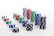 Cutout of stacks of gambling chips on white background