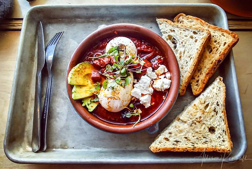 A delicious bowl of shakshuka served with fresh whole-grain bread at the restaurant Miss Browns, in downtown Winnipeg, Manitoba