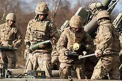 Royal Artillery gun crew loading an L118 105mm light gun during exercise Steel Sabre. A large Scale military live fire exercise on Otterburn Training Area it involves 1400 troops the majority from the Royal Artillery 1st Artillery Brigade and brings all the components of an effective Artillery group together to train in delivering firepower on the battlefield.<br /> <br />   02 March 2017 <br />   Copyright Paul David Drabble<br />   www.pauldaviddrabble.co.uk