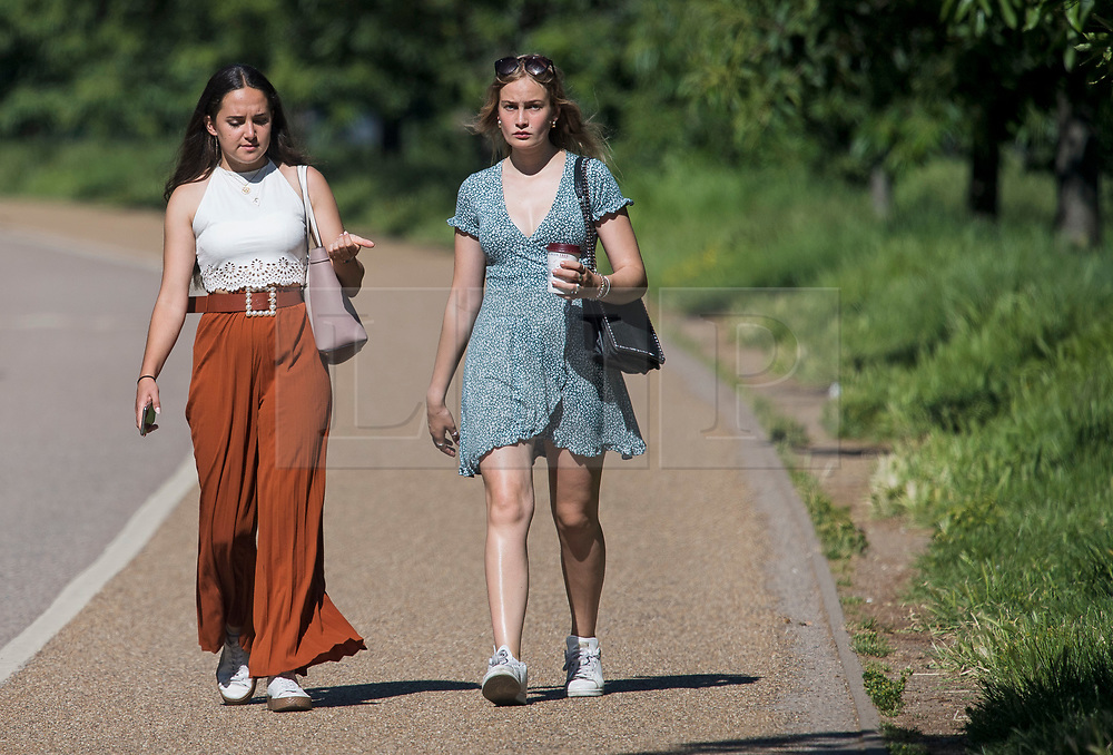 © Licensed to London News Pictures. 13/06/2021. London, UK. Members of the public enjoy the warm weather in Hyde Park central London on a hot summer's day. Temperatures in the capital are expected to reach a high for the year. Photo credit: Ben Cawthra/LNP