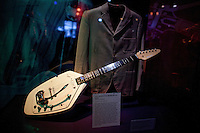 John Lennon electric guitar and jacket on display at The Rock and Roll Hall of Fame Annex in New York City..(Photo by Robert Caplin)..