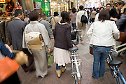 various people walking through a shopping arcade in Kyoto Japan