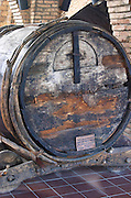 Ancient medieval oak vat on an old cart. Codorniu, Sant Sadurni d'Anoia, Penedes, Catalonia, Spain