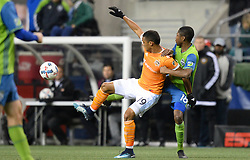 November 30, 2017 - Seattle, Washington, U.S - Soccer 2017: MAURO MANOTAS (19) and KELVIN LEERDAM (18) battle for the ball as the Houston Dynamo play the Seattle Sounders in the 2nd leg of the MLS Western Conference Finals match at Century Link Field in Seattle, WA. (Credit Image: © Jeff Halstead via ZUMA Wire)