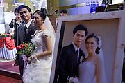 08 MARCH 2006 - HO CHI MINH CITY, VIETNAM: A wedding in Ho Chi Minh City, Vietnam. HCMC is still widely known as Saigon. PHOTO BY JACK KURTZ
