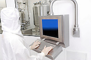 Worker in Clean Room suit at a Pharmaceuticals manufacturing plant