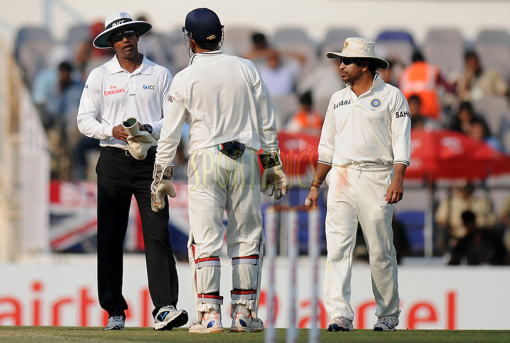 Field umpire Kumara Dharmasena has a word with MS Dhoni captain of India as Sachin Tendulkar of India looks on during day four of the 4th Airtel Test Match between India and England held at VCA ground in Nagpur on the 16th December 2012..Photo by  Pal Pillai/BCCI/SPORTZPICS .