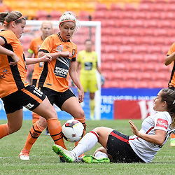 BRISBANE, AUSTRALIA - JANUARY 7: Maddy Evans of the Roar is tackled by Paige Nielsen of the Wanderers during the round 11 Westfield W-League match between the Brisbane Roar and Western Sydney Wanderers at Suncorp Stadium on January 7, 2017 in Brisbane, Australia. (Photo by Patrick Kearney/Brisbane Roar)