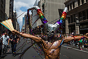 New York, NY - 30 June 2019. The New York City Heritage of Pride March filled Fifth Avenue for hours with participants from the LGBTQ community and it's supporters. A man wears a horned mask covered in reflective tiles.