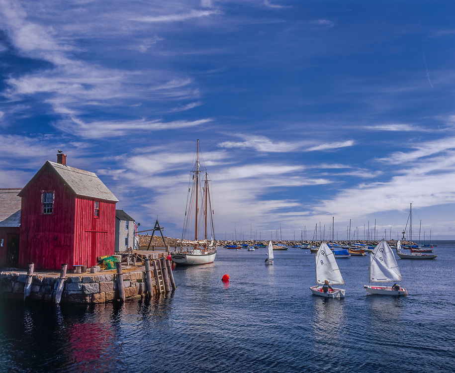 Motif #1, one side in shadow, litttle sailboats in harbor, Rockport, MA