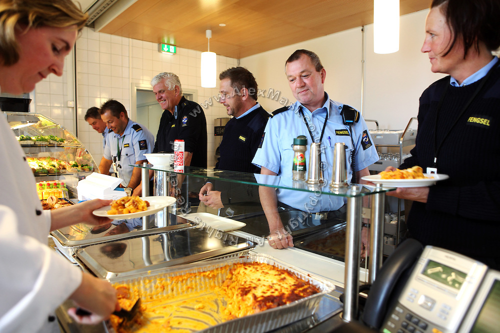 Guards are lining up for lunch at the deli bar inside the luxurious Halden Fengsel, (prison) near Oslo, Norway.