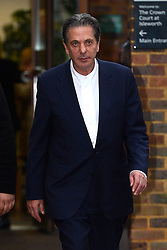 Charles Saatchi leaves Isleworth Court during the fraud trial against Nigella Lawson's two former assistants, Elisabetta Grillo and Francesca Grillo.<br />