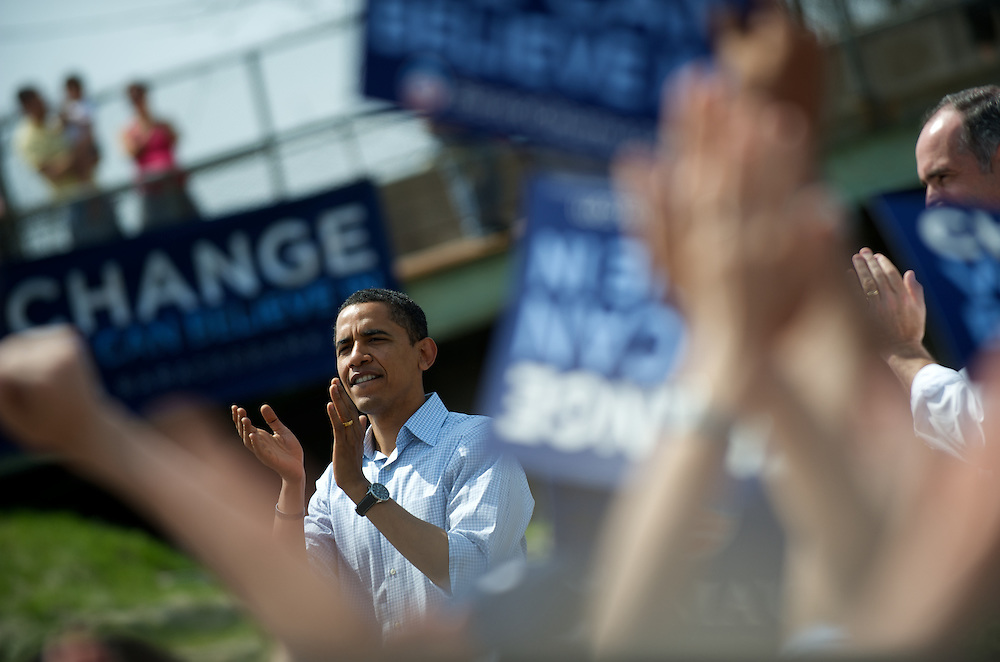 Senator Barack Obama claps along with supporters at a campaign stop in Paoli, Pennsylvania.