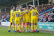 Goal celebration by Wimbledon forward James Hanson (18) after his second goal during the EFL Sky Bet League 1 match between Scunthorpe United and AFC Wimbledon at Glanford Park, Scunthorpe, England on 30 March 2019.