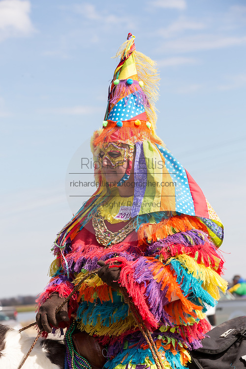 Costumed revelers during the Eunice Courir de Mardi Gras chicken run on Fat Tuesday February 17, 2015 in Eunice, Louisiana. The traditional Cajun Mardi Gras involves costumed revelers competing to catch a live chicken as they move from house to house throughout the rural community.