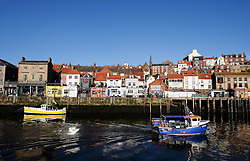© Licensed to London News Pictures. <br /> 13/05/2015. <br /> <br /> Whitby, United Kingdom<br /> <br /> A fishing boat sails out of Whitby Harbour as it heads out into the North sea to go fishing.<br /> <br /> <br /> Photo credit : Ian Forsyth/LNP