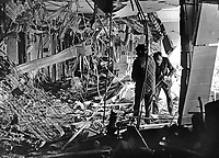 Aftermath of last night's Provisional IRA bomb blast at the Europa Hotel, Belfast, N Ireland, in which 5 people suffered minor injuries. Experts check the seat of the explosion on the second floor for any signs of structural damage. 1975120200760EH.<br />