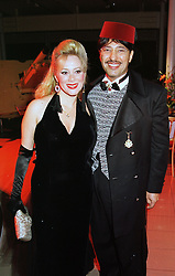MRS MONA BAUWENS and PRINCE MUBAREK AL SABAH at a party in London on 31st January 1998.MEZ 51