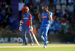 India's Mohammed Shami celebrates taking the wicket of Afghanistan's Mujeeb Ur Rahman during the ICC Cricket World Cup group stage match at the Hampshire Bowl, Southampton.