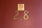non smoking sign on motel door