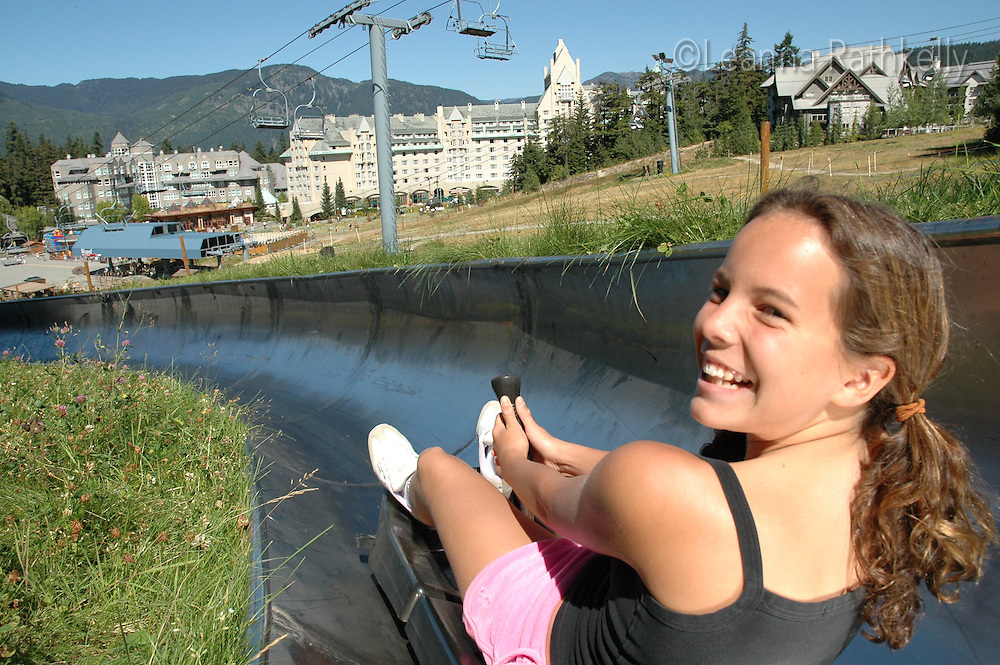 Girl 10-12 enjoys a Westcoaster slide ride at the Blackcomb Adventure Zone, Whistler, BC