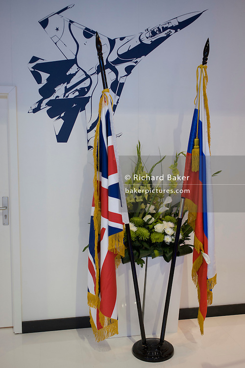 """British and Russian flags displayed beneath the image of a Migoyan jet fighter at the Farnborough Air Show, England. Russia's deputy prime minister told his country's defence delegates to withdraw from the Farnborough International Airshow and return home after being snubbed by the British government over the Ukraine conflict. Dmitry Rogozin, who heads Russia's defence sector as deputy prime minister, said: """"I recommend our delegation to wind up its participation in the show and return home."""""""