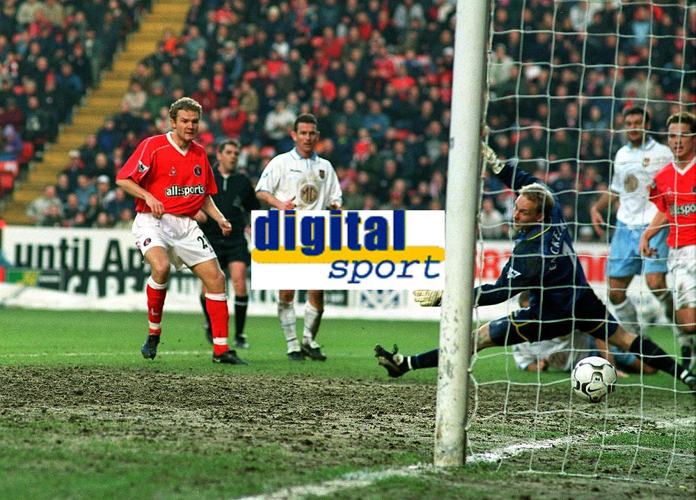 Jonatan Johansson (Charlton) scores goal no.2 past Peter Enckelman (Villa). Charlton Athletic v Aston Villa. 22/2/2003. Credit : Colorsport/Andrew Cowie.