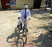 Indian boy, 10, claims his sense of smell is so strong he can identify colours, ride a bike and walk unaided while blindfolded<br /> <br /> A ten-year-old Indian boy claims to have taught himself the ability recognise colours through his sense of smell with 'mind-training'. <br /> Vikas Panchal, from Delhi, says he has also learned how to ride a bike, walk around unaided, and picking out a particular classmate from a line of fellow pupils, all while blindfolded. <br /> He claims to have developed his unusual skills by spending two hours per day practising a particular type of mind exercise technique. <br /> <br /> A video of Vikas demonstrating his abilities shows him picking up different colour balls and beads while having his eyes completely covered.<br /> After smelling them for a few seconds, he then describes the colour, even differentiating between two different shades.<br /> <br /> Other footage shows him blindfolded and riding a bicycle around his school playground and wandering around his local neighbourhood in Delhi  wearing a blindfold while dodging potholes and pedestrians.<br /> Vikas says his skills have been developed through a mind-training technique known as Midbrain Activation.<br /> It targets the stimulation of a small part of the brain that acts as a relay centre for information gathered from the body's visual, auditory and motor systems.<br /> <br /> It is claimed that people who develop their midbrain will never forget what they have seen or heard just once previously.<br /> As a result, then are said to be able to carry out everyday tasks quite literally with their eyes closed.<br /> Vikas spends two hours each day practising the technique and says it has also transformed his schooling and seen him rise to the top of his class.<br /> His trainer Shri Bhagwan, said: 'His training is like meditation. We sit in a silent place and shut our eyes.<br /> 'Everyone's mind has two parts. One part is the left side and other part is the right side.<br /> 'Our right side is more active than the left side. With this technique we activate the lazy side of our mi