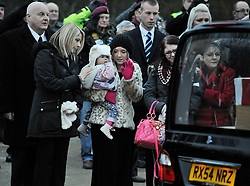 © Licensed to London News Pictures. 17 Jan 2013. Brize Norton, Oxfordshire. His baby Lilly Faith Walker (20mths) and his girlfriend Abbie Revill (23yrs) pay their tributes to the cortege. Repatriation of Sapper Richard Reginald Walker from 28 Engineer Regiment who was shot in an apparent 'insider attack' by a member of the Afghan National Army (ANA) at Patrol Base Hazrat in the Nahr-e Saraj district of Helmand province on Monday 7 January 2013 . Photo credit : MarkHemsworth/LNP