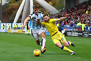 Emyr Huws of Huddersfield Town (l) and Stuart Dallas of Leeds united (r) battle for the ball. Skybet football league Championship match, Huddersfield Town v Leeds United at the John Smith's Stadium in Huddersfield, Yorks on Saturday 7th November 2015.<br /> pic by Chris Stading, Andrew Orchard sports photography.