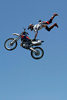 """Jul 01, 2003; Anaheim, California, USA; Moto X star athlete RONNIE RENNER executing a tremendous stunt hands free with a full sized motobike at the opening of Disney's California Adventure """"X Games Experience"""".  Disney park has built two X-Arena's specifically for this 41 day event highlighting extreme sports for the launch of the 2003 ESPN X Games.<br />Mandatory Credit: Photo by Shelly Castellano/Icon SMI<br />(©) Copyright 2003 by Shelly Castellano"""