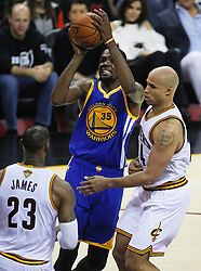 June 9, 2017 - Cleveland, OH, USA - The Golden State Warriors' Kevin Durant, middle, puts a shot up against the Cleveland Cavaliers' Richard Jefferson in the second quarter during Game 4 of the NBA Finals at Quicken Loans Arena in Cleveland on Friday, June 9, 2017. (Credit Image: © Leah Klafczynski/TNS via ZUMA Wire)