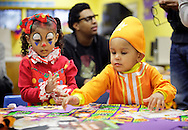 Middletown, New York  - Children in costumes make crafts at a table during the Middletown YMCA Family Fall Festival on Oct. 29, 2011. ©Tom Bushey / The Image Works