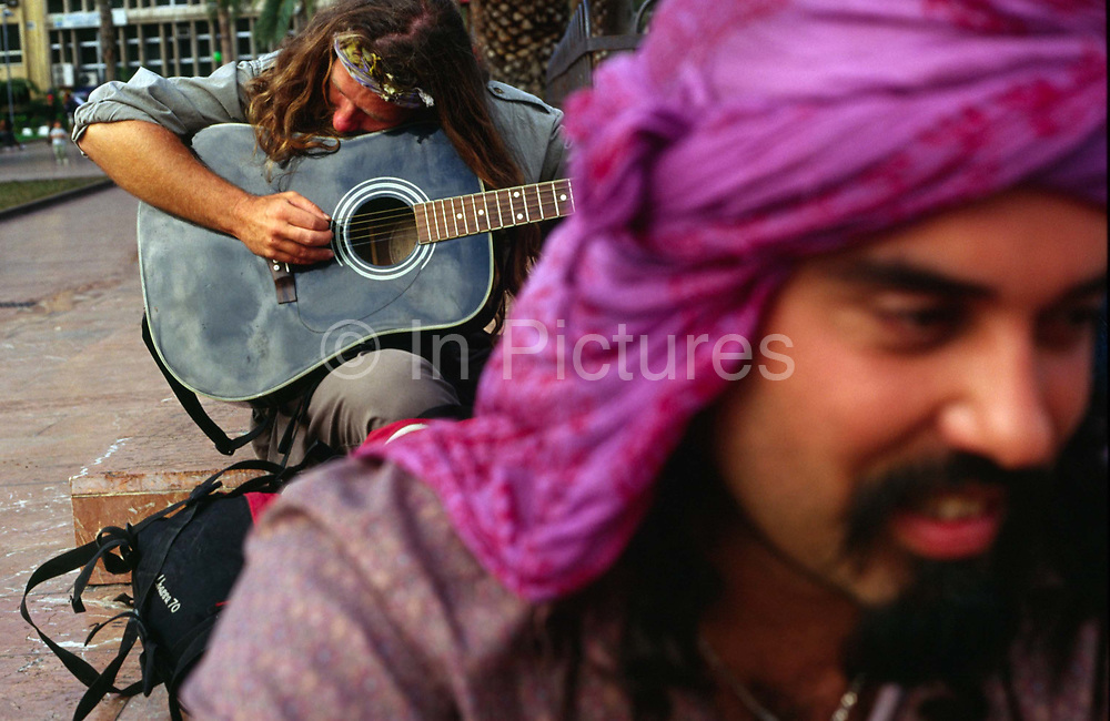 A musician plays his guitar with his friend in Las Palmas, the capital of Gran Canaria during the WOMAD festival of World Music on the Canary Islands. Las Palmas, Gran Canaria