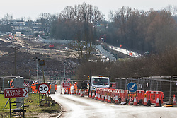 Harefield, UK. 13th February, 2021. A road closure on Harvil Road in the Colne Valley is maintained by security guards acting on behalf of HS2 Ltd in order to facilitate the felling (behind) of some of the few remaining trees in the area for the HS2 high-speed rail link. Four anti-HS2 activists had been evicted from a roadside camp and three from nearby trees by bailiffs acting for HS2 Ltd during the night.