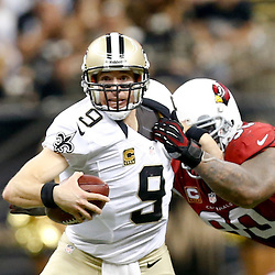 Sep 22, 2013; New Orleans, LA, USA; Arizona Cardinals defensive end Calais Campbell (93) sacks New Orleans Saints quarterback Drew Brees (9) during the second half of a game at Mercedes-Benz Superdome. The Saints defeated the Cardinals 31-7. Mandatory Credit: Derick E. Hingle-USA TODAY Sports