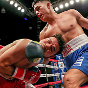 KISSIMMEE, FL - MARCH 05: Gianny Garcia catches Julio Buitrago with a punch during the Boxeo Telemundo All Star Boxing event at Osceola Heritage Park on March 5, 2021 in Kissimmee, Florida. (Photo by Alex Menendez/Getty Images) *** Local Caption *** Gianny Garcia; Julio Buitrago