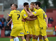 Reuben Reid celebrates scoring his second goal during the Sky Bet League 2 match between Cheltenham Town and Plymouth Argyle at Whaddon Road, Cheltenham, England on 28 March 2015. Photo by Alan Franklin.