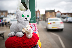© Licensed to London News Pictures. 27/04/2016. Thirsk UK. Picture shows  a knitted cat on a bollard in Thirsk that has been Yarn Bombed. Under the cover of Darkness 300 Yarn bombing street artist's have covered the Town centre of Thirsk, the group has covered bollards, flower pots, the bus stop, tree's, benches, even the local police station. The knitted creations took over 750 balls of wool & have been placed along the route of the Tour De Yorkshire which will pass through the town during it's final stage from Middlesborough to Scarborough on Sunday.  Photo credit: Andrew McCaren/LNP