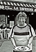 waitress in france,serving lunch,blak and white,verticle