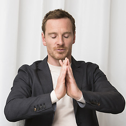 May 4, 2017 - London, United Kingdom, U.S. - MICHAEL FASSBENDER promotes 'Alien Covenant.' Michael Fassbender (born April 2, 1977) is a German-born Irish actor. His feature film debut was in the fantasy war epic 300 (2007) as a Spartan warrior; his earlier roles included various stage productions, as well as starring roles on television such as in the HBO miniseries Band of Brothers (2001) and the Sky One fantasy drama Hex (2004–05). He first came to prominence for his role in Hunger (2008), for which he won a British Independent Film Award. Subsequent roles include in the independent film Fish Tank (2009), as a Royal Marines lieutenant in Inglourious Basterds (2009), A Dangerous Method (2011), Prometheus (2012), and in the musical comedy-drama Frank (2014), The Snowman (2017), Alien Covenant (2017), Song to Song (2017). (Credit Image: © Armando Gallo via ZUMA Studio)