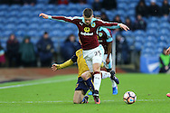 Johann Gudmundsson of Burnley gets away from a tackle from Joe Bryan of Bristol City. The Emirates FA cup 4th round match, Burnley v Bristol City at Turf Moor in Burnley, Lancs on Saturday 28th January 2017.<br /> pic by Chris Stading, Andrew Orchard Sports Photography.