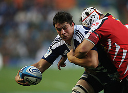 Francois Louw is tackled by a Lions player during the Super Rugby (Super 15) fixture between the DHL Stormers and the Lions held at DHL Newlands Stadium in Cape Town, South Africa on 26 February 2011. Photo by Jacques Rossouw/SPORTZPICS