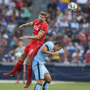 Steven Gerrard, Liverpool, wins a header over Stevan Jovetic, Manchester City, during the Manchester City Vs Liverpool FC Guinness International Champions Cup match at Yankee Stadium, The Bronx, New York, USA. 30th July 2014. Photo Tim Clayton