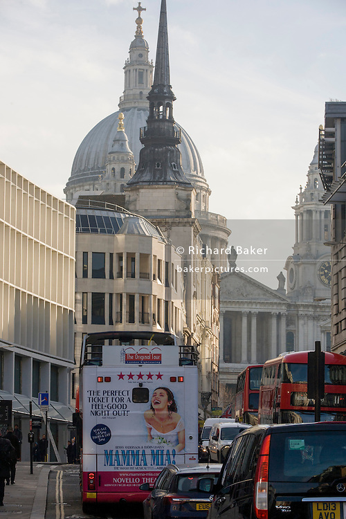 Bus rear advertising for Abba's West End musical Mamma Mia as it drives up Ludgate Hill and central London streets.