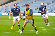 Ali Price (#9) (Glasgow Warriors) of Scotland passes the ball, as Hamish Watson (#7) (Edinburgh) of Scotland watches on, during the Scotland Team Run at BT Murrayfield, Edinburgh, Scotland on 22 October 2020, ahead of Scotland v Georgia.