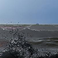 Heavy surf pounds the California coast near Half Moon Bay, California.